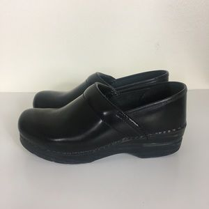 Dansko Black Leather Professional Stapled Clogs
